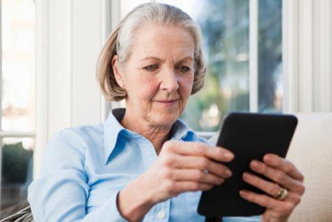 Senior woman reading kindle_for web